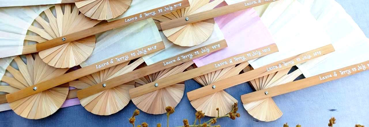 Hand painted names & date on the bamboo wedding fan handle