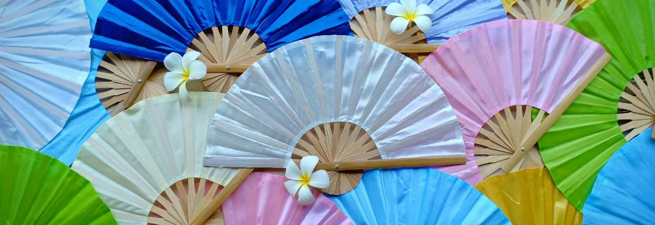 Solid color silky fabric wedding fans in assorted colors