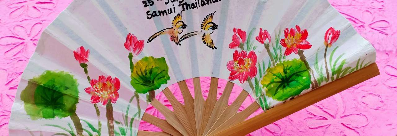 Name, date and place hand painted on the bamboo wedding fan body