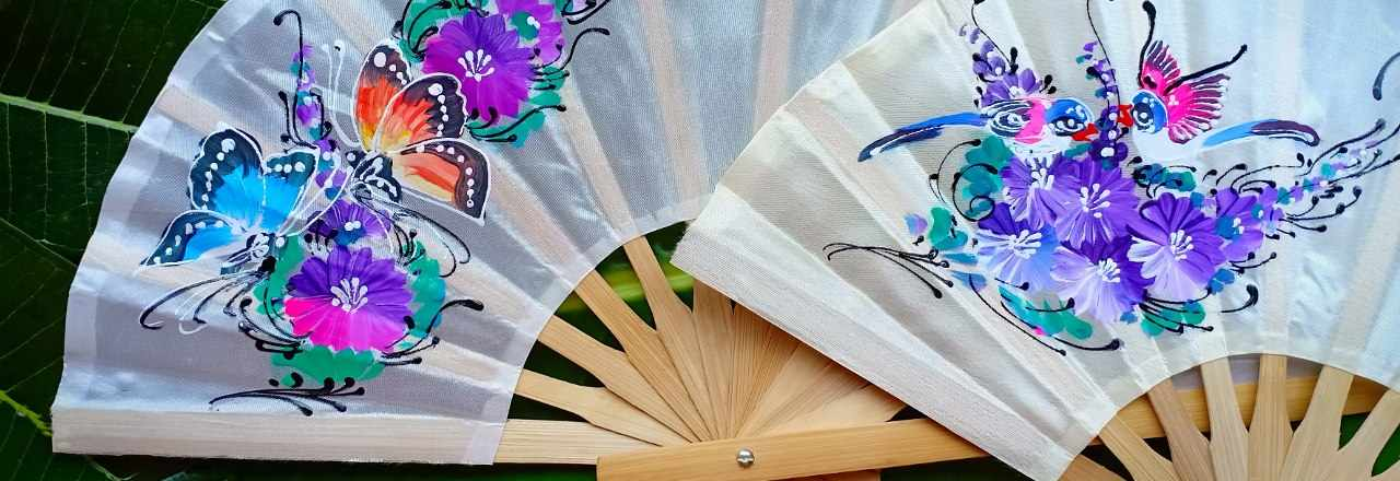Two hand painted silky fabric wedding fans, with with matching themes flowers butterflies birds