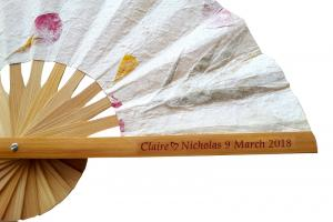 Clear Sticker with Names and Date on a Pressed Flowers Wedding Fan