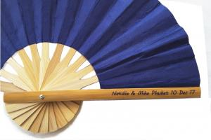 Clear sticker showing wedding names, place and date on the handle of a bamboo wedding fan